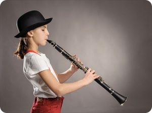 sunset hills mo orthodontist play instrument with braces